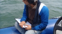 Listening to bottlenose dolphins while noting behaviour